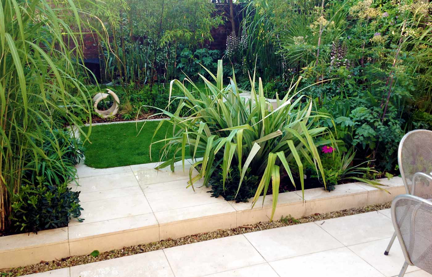 Limestone, structural evergreen planting in contemporary garden