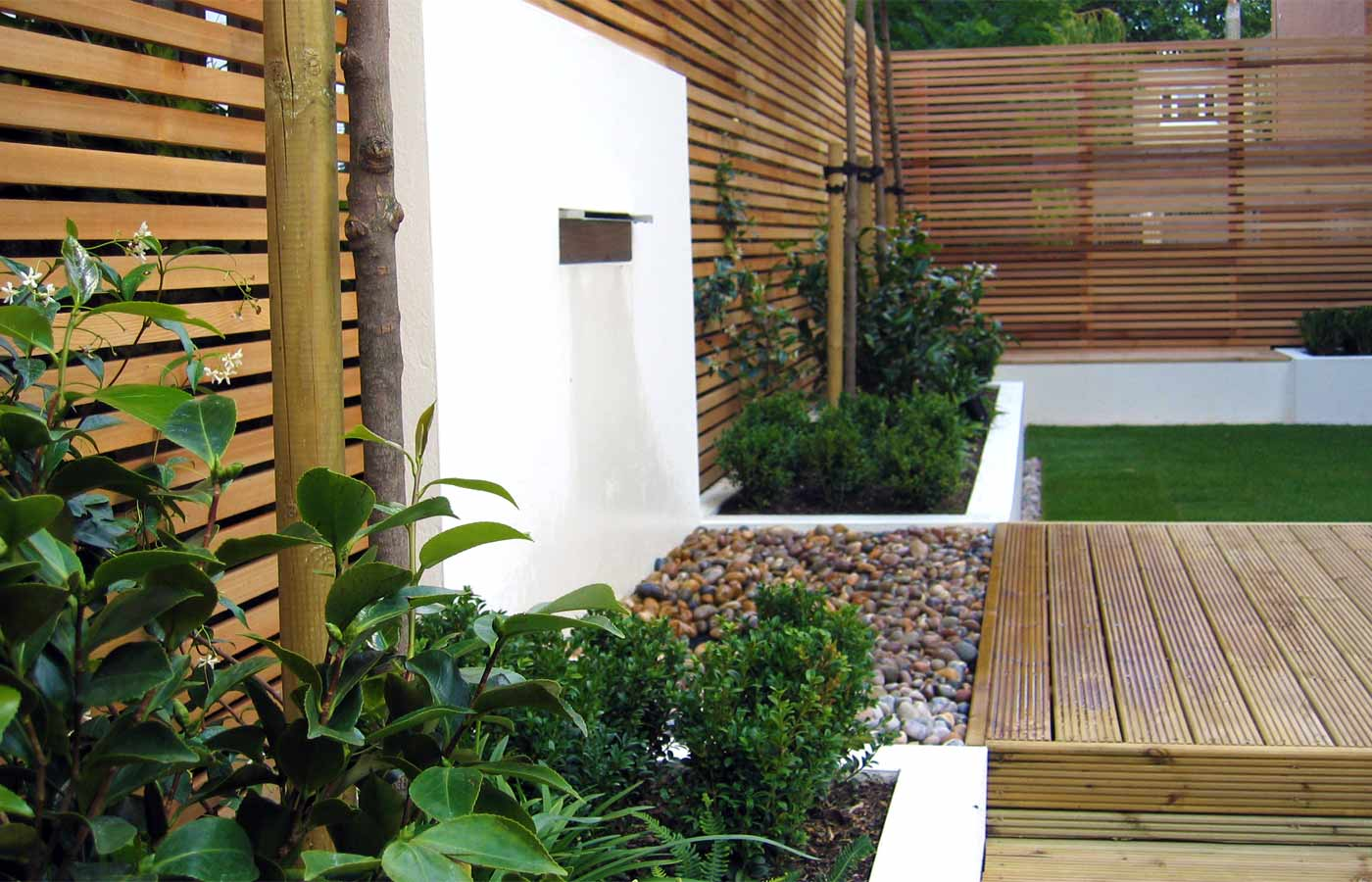 Decking, rendered walls, water and structural planting