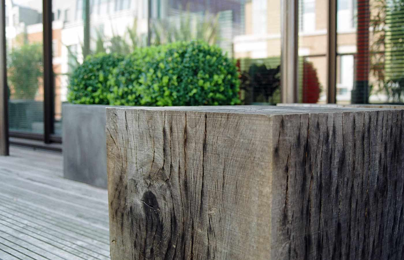 Wooden cubes and planters on roof terrace