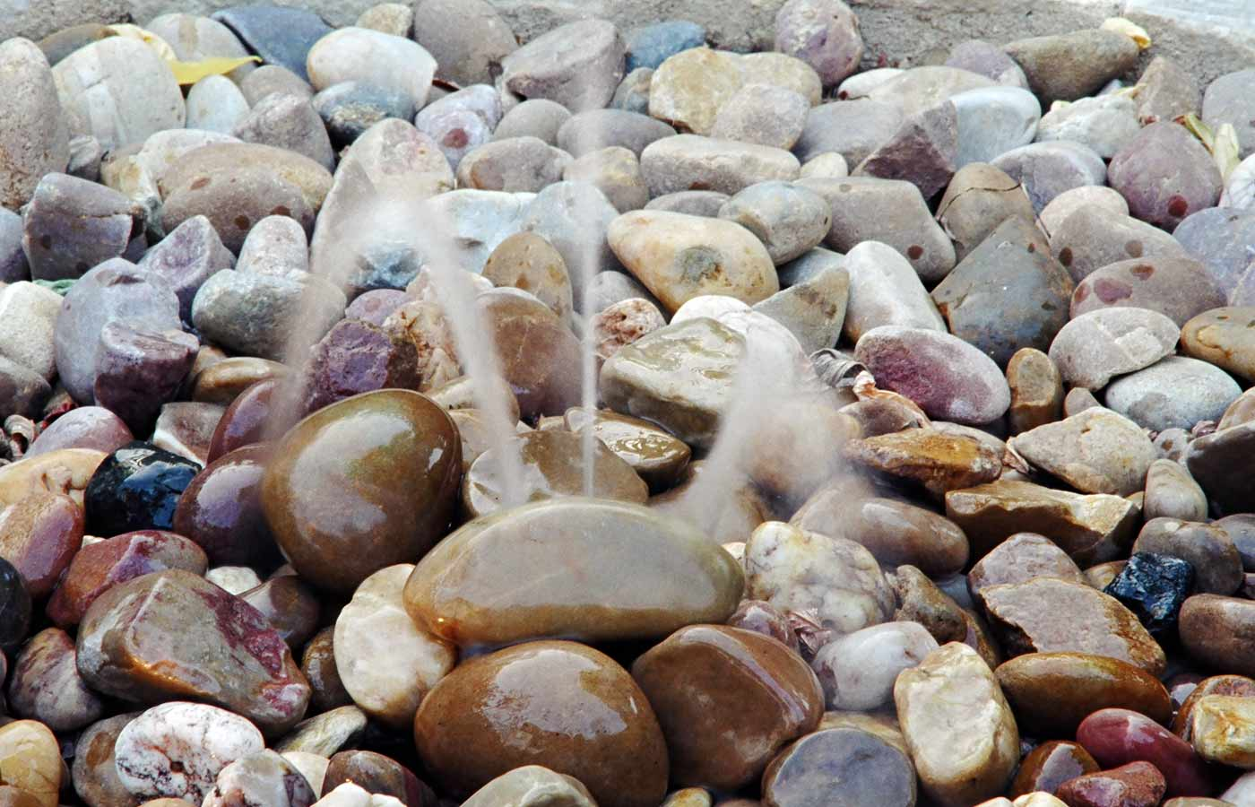 Water fountain in pebbles