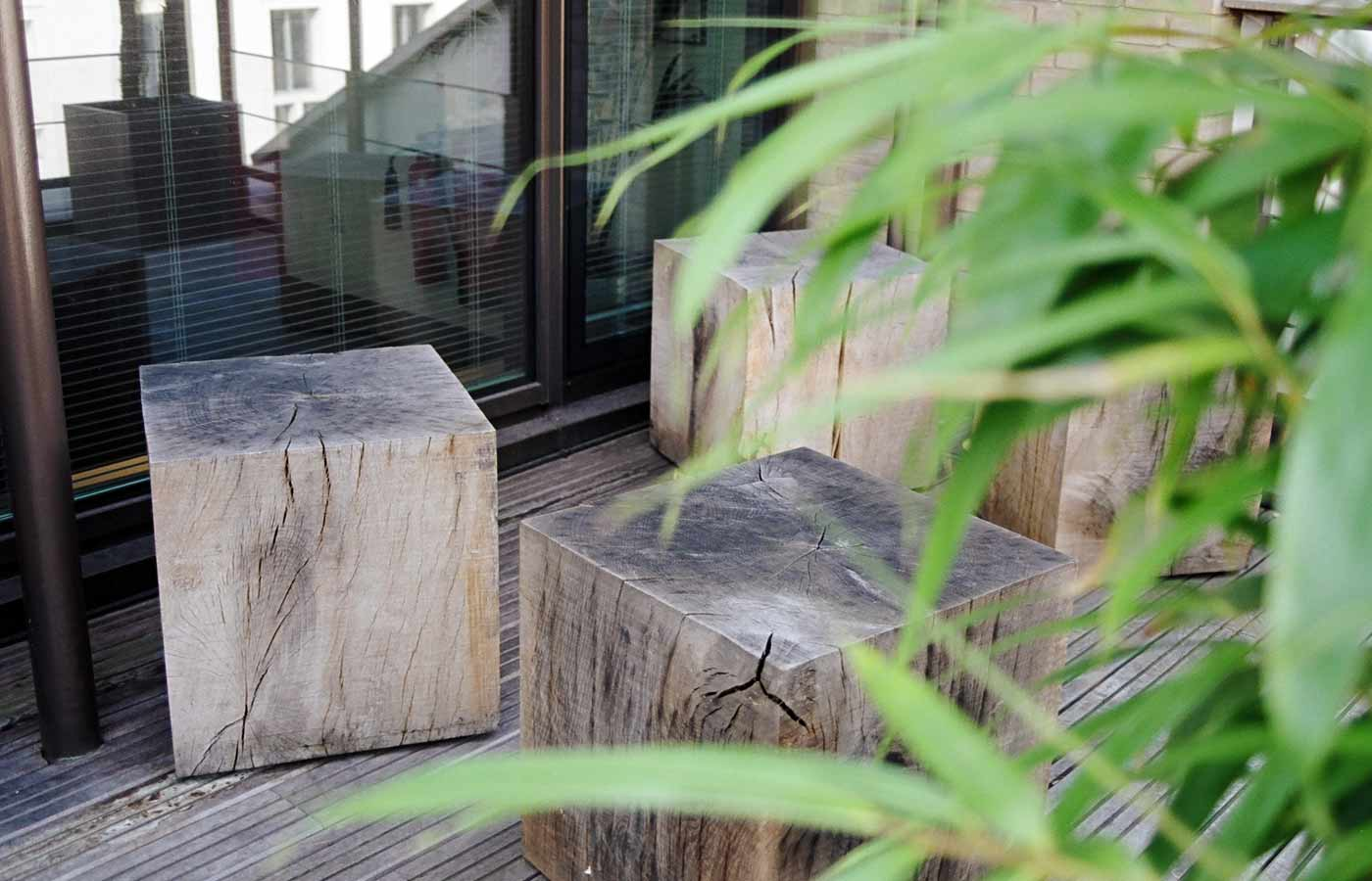 Green oak cubes for seating on the roof garden