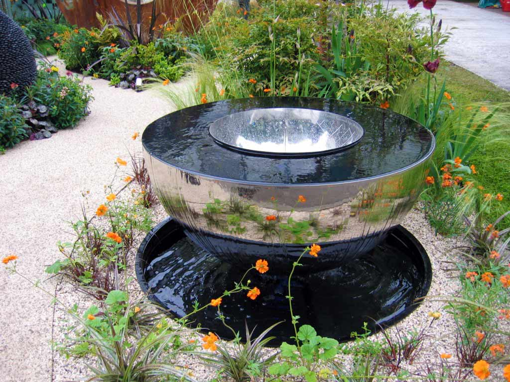 Pretty country style flowers by water feature